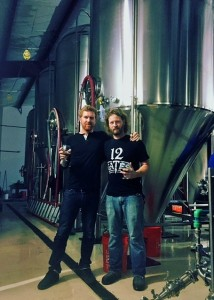 Shawn Kerr, right, standing in front of his first brew.